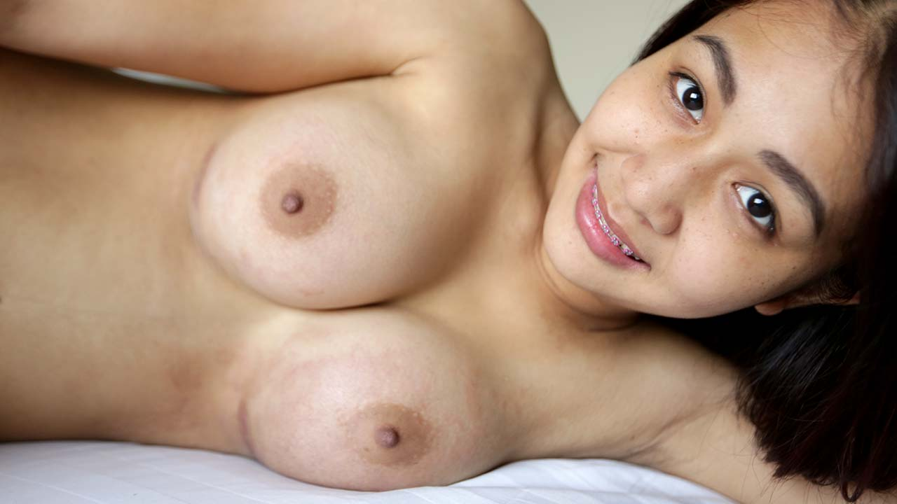 Cute Thai bed-buddy Fon showing off her new big boobs